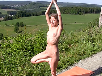 Naked yoga on public road