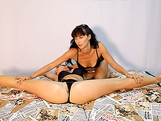 Sensual lesbian yoga performance by the nearly nude gymnasts