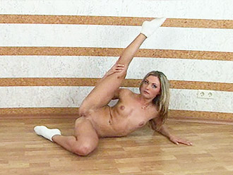 Nude gymnast shows her pussy while doing naked yoga