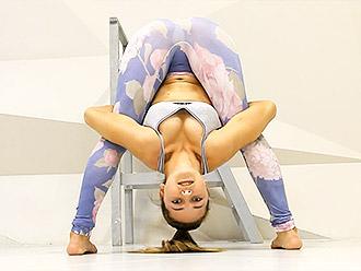 Sexy flexible girl in tight yoga pants did hot yoga video